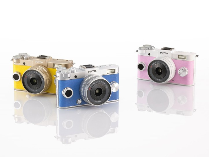 Some fun colour variants of the Pentax Q-S1 - separate blue and pink variants with silver/chrome top plate, and yellow with a champagne top plate.