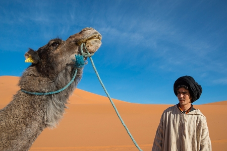 Man and Camel, Morrocco. Taken with Tamron 16-300mm at 16mm. Promotional image by Tamron.